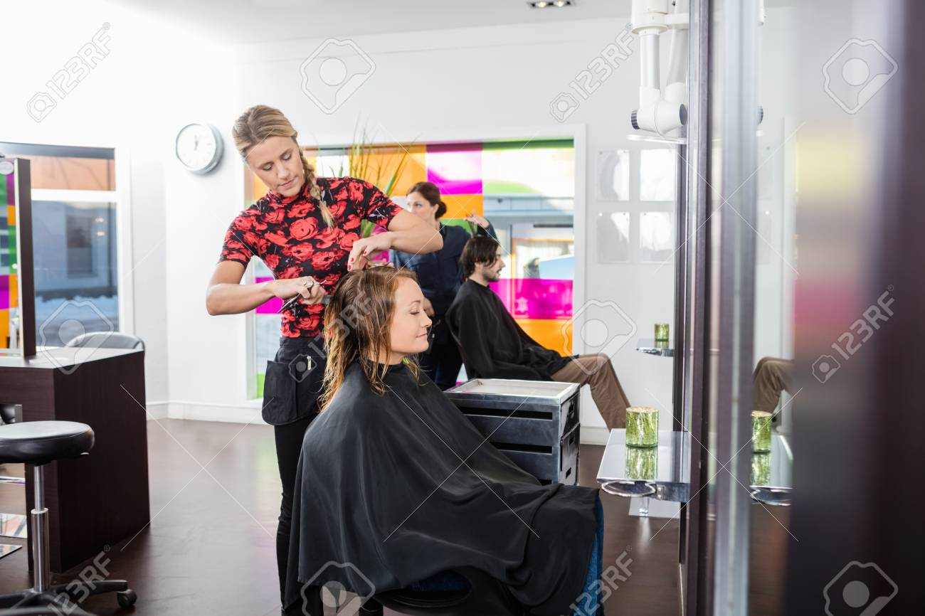 Mature Haircut   Mature Woman Getting Haircut By Female Hairstylist At Beauty Stock