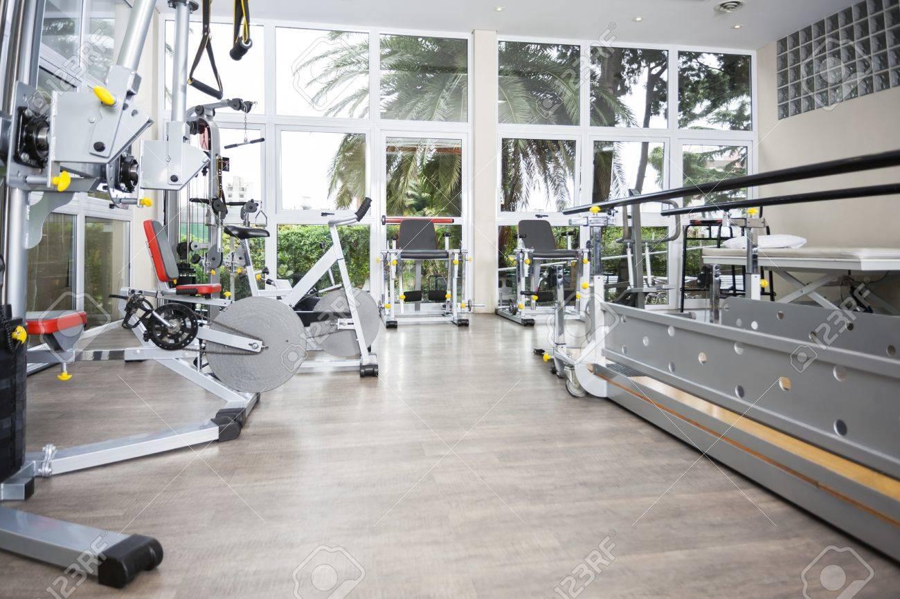 Exercise equipment in fitness studio of rehab center - 56717411