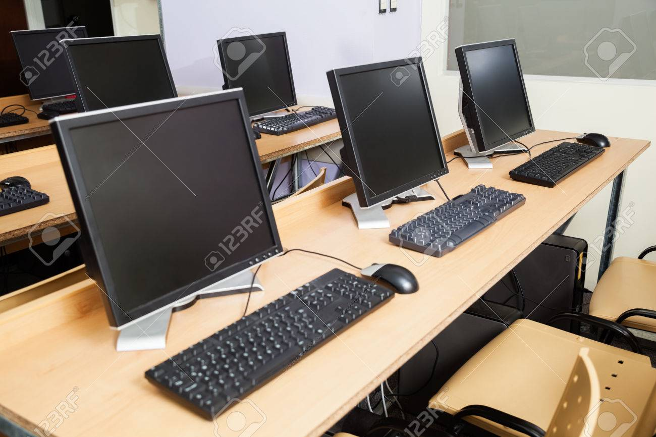 Row Of Computers On Desks In Classroom Stock Photo   58142357