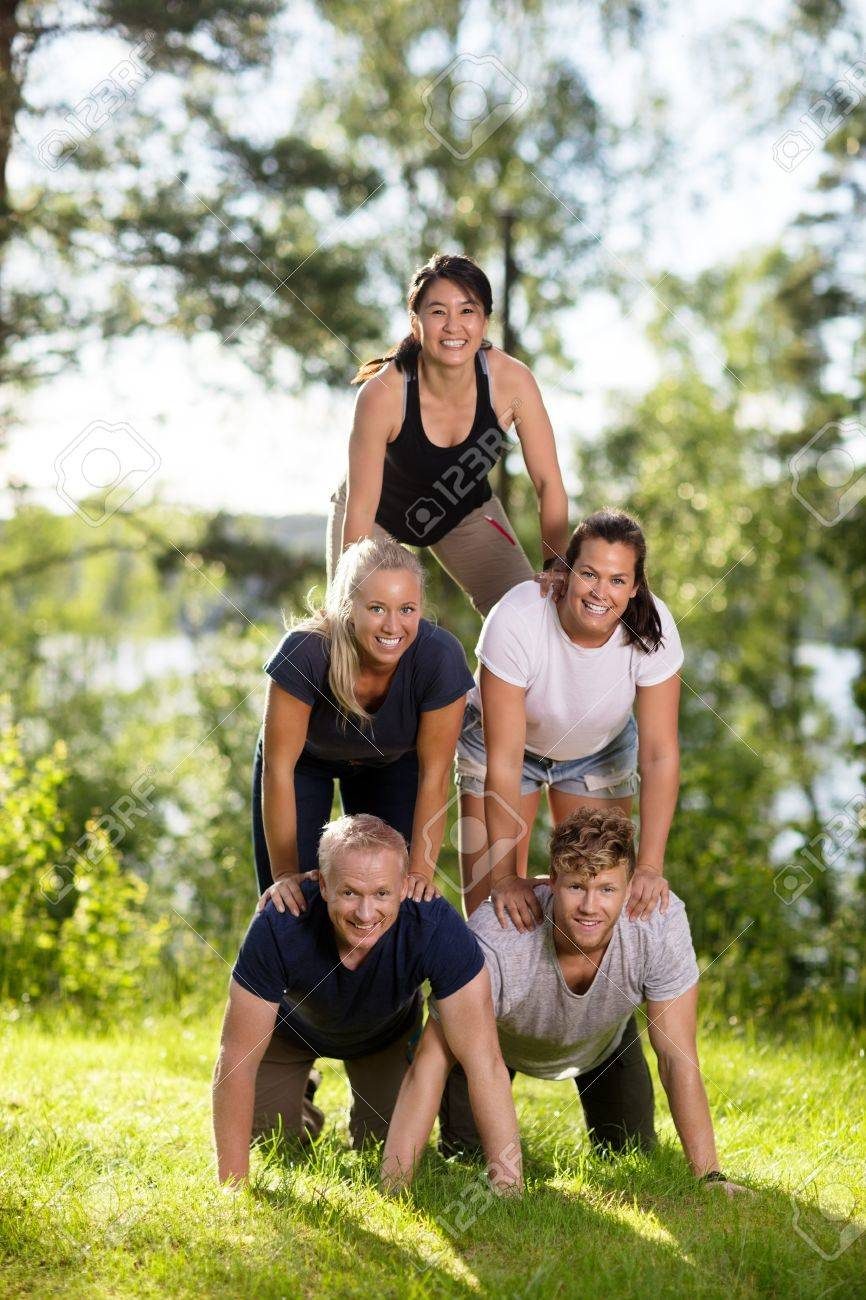 Portrait Of Multiethnic Business People Making Human Pyramid On - 84186455