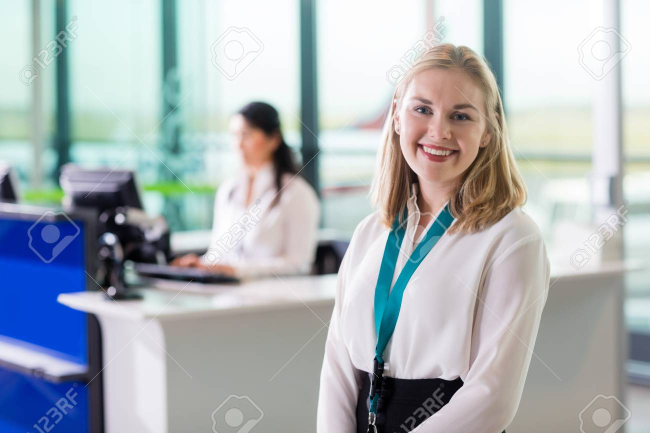 Young Ground Staff Smiling While Colleague Working At Airport Re - 93213901