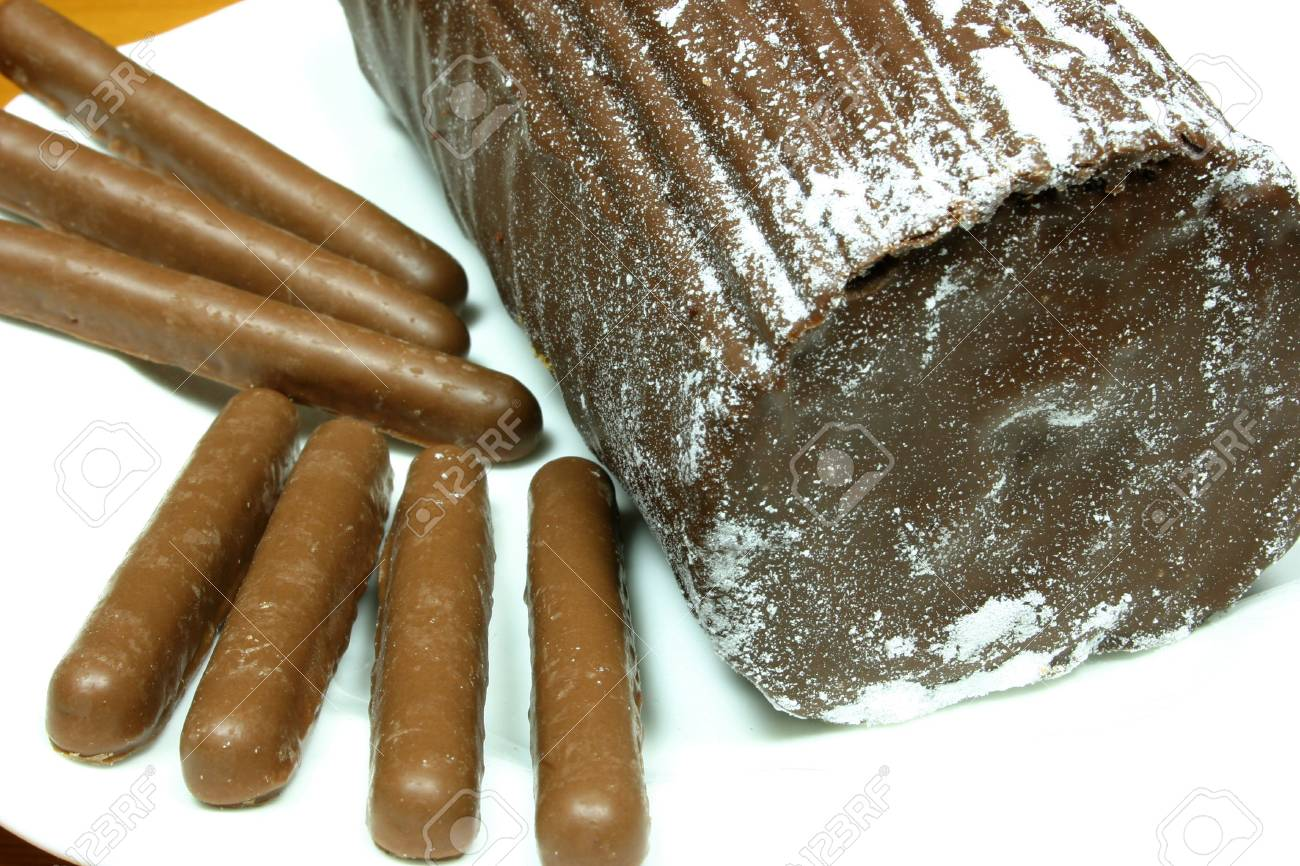 chocolate yulelog and chocolate finger biscuits for a treat Stock Photo - 932673