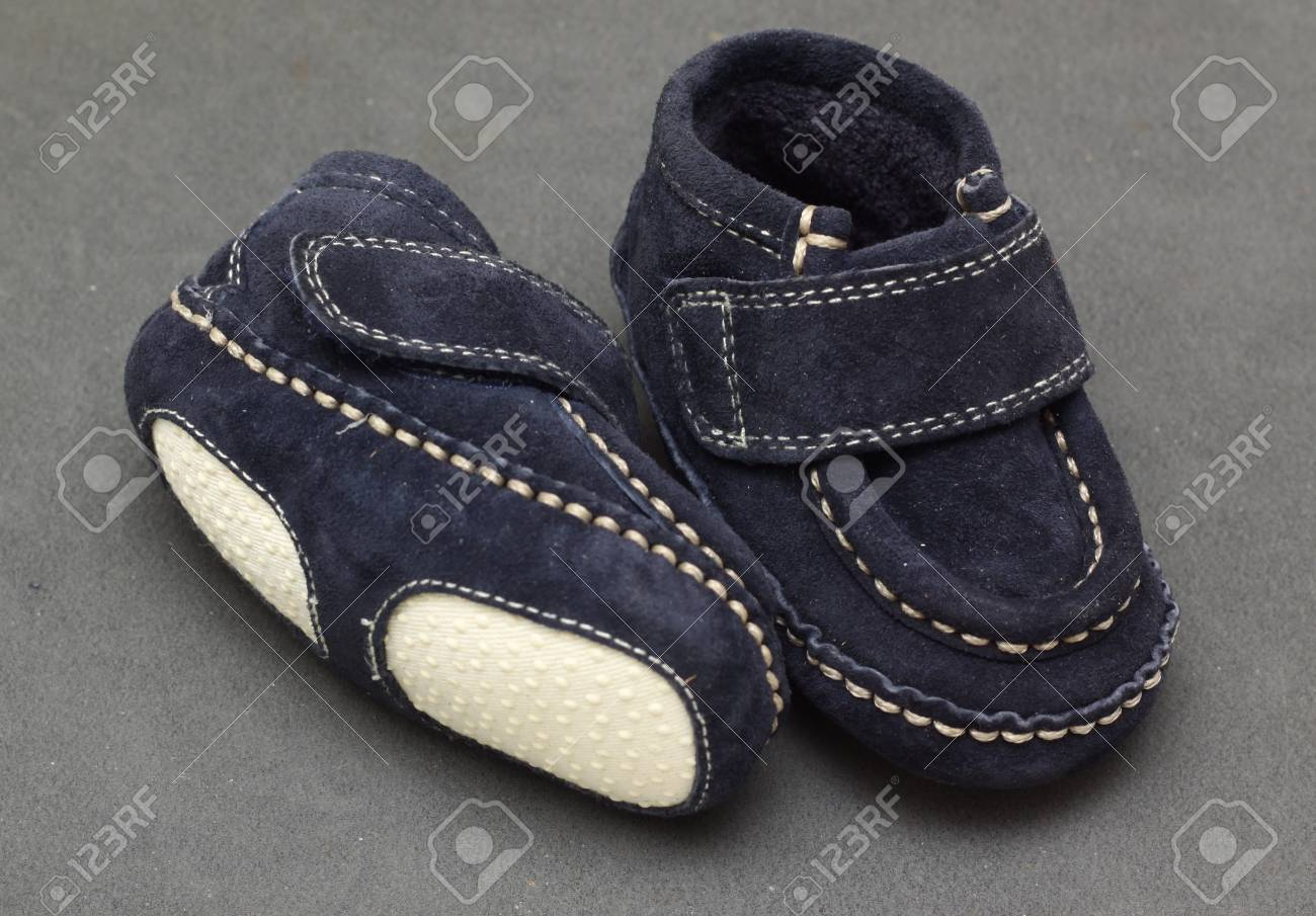 small blue pair of baby boy soft shoes Stock Photo - 10671799