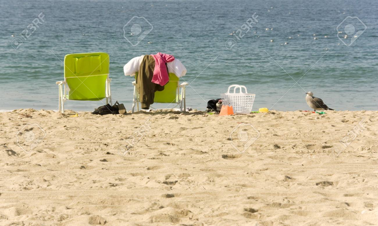 2 beach chairs on the beach - 2 Beach Chairs And Accessories In The Sand Two Empty Beach Chairs Clothing Toys