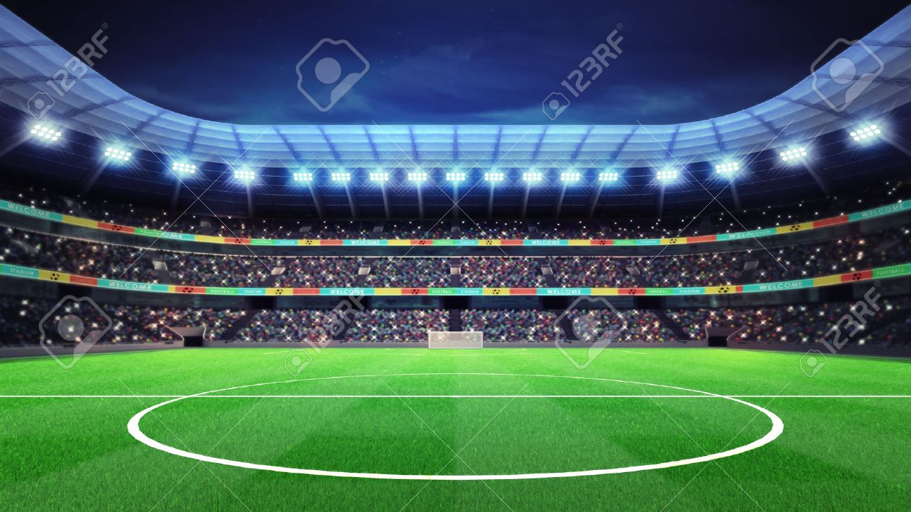 lighted football stadium with fans in the stands sport match stock