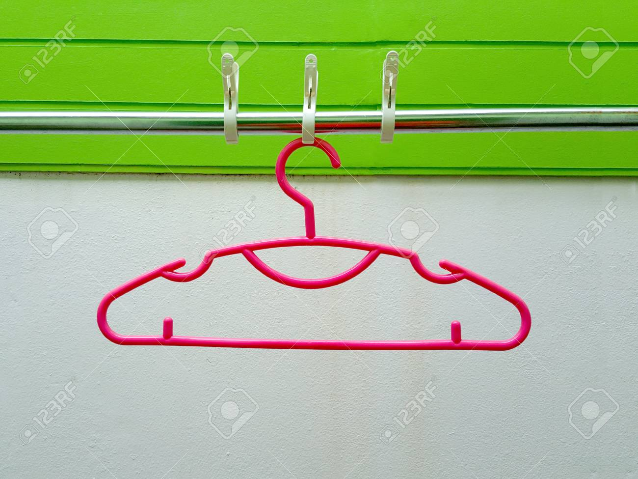 White Clothes Peg On Clothes Line On Green Wall Stock Photo, Picture ...