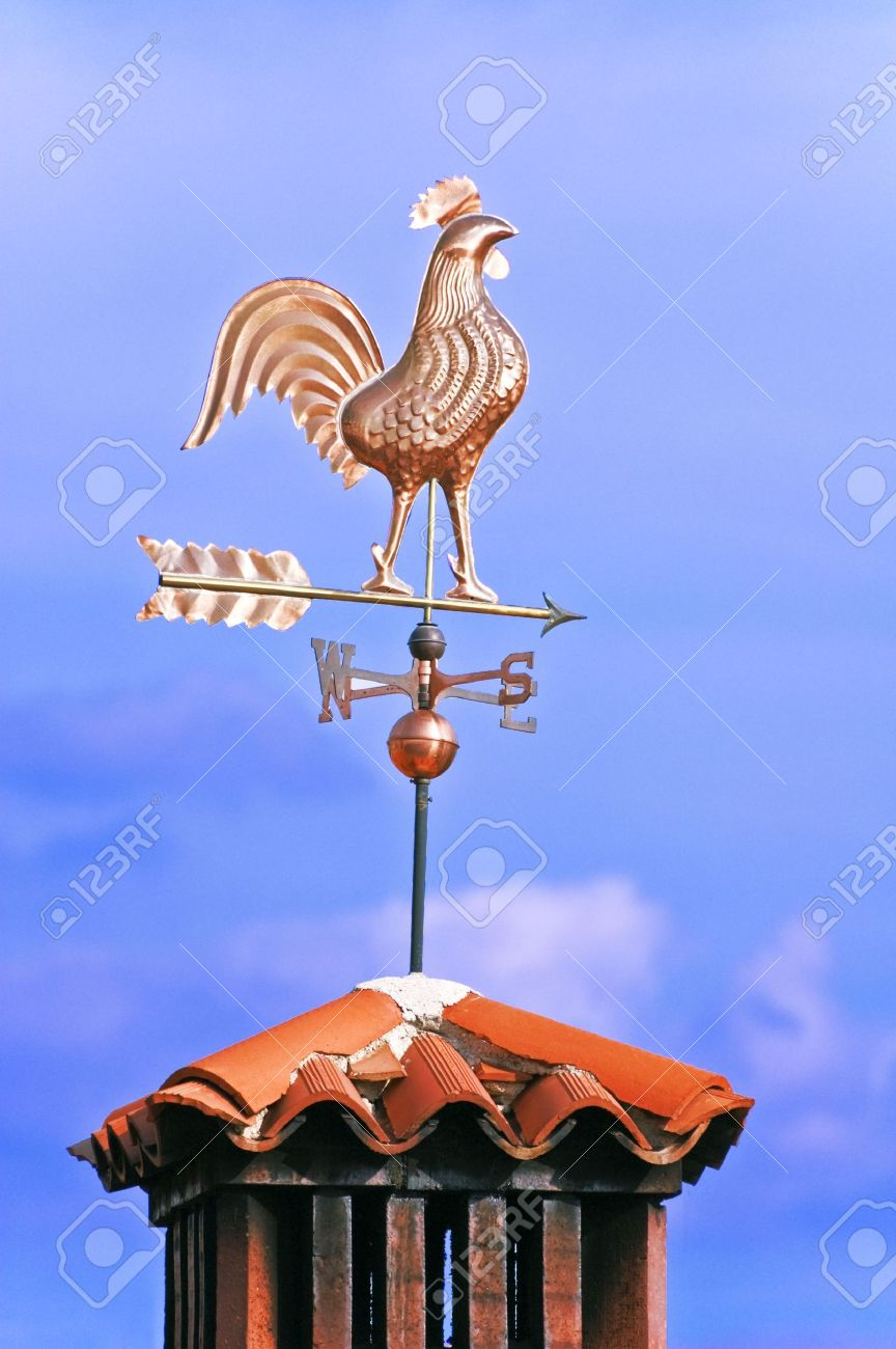 A weathercock indicates wind direction on a chimney pot Stock Photo - 2110164