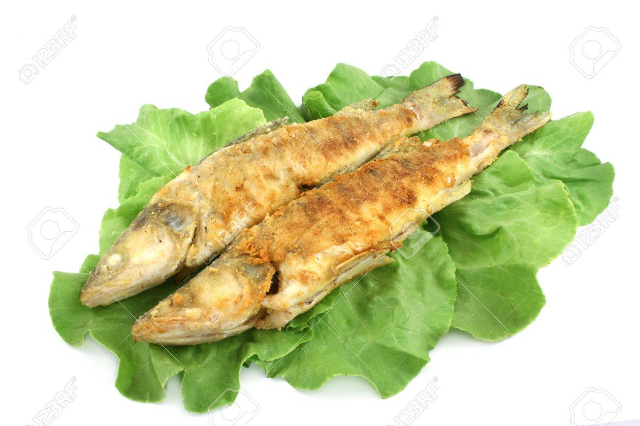 two fried fishes on lettuce Stock Photo - 3428504