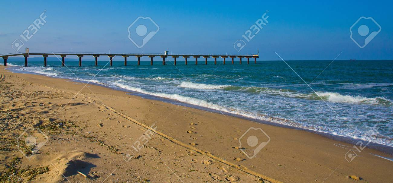 A view on a coastal strip with a wharf Stock Photo - 15279021