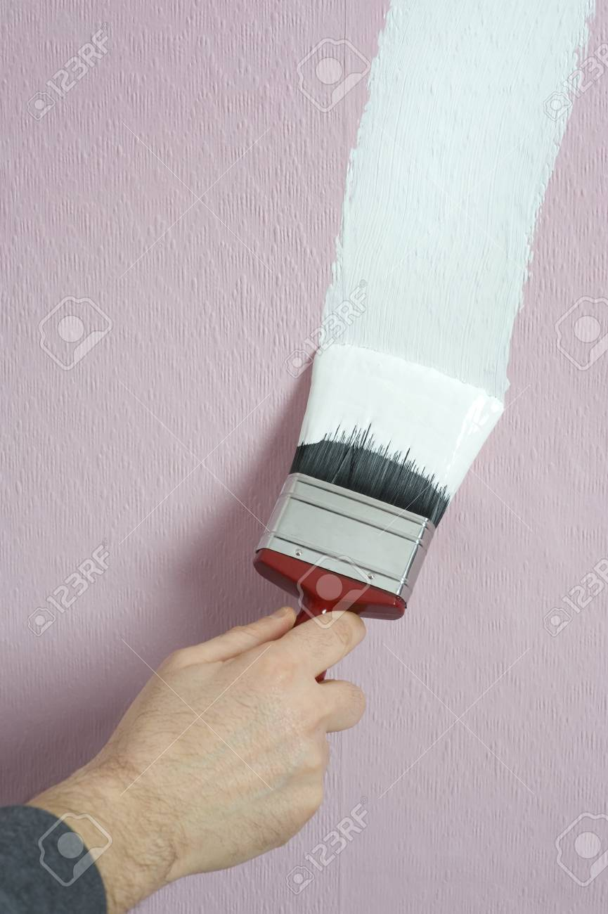 man decorating or painting with a paint brush Stock Photo - 12664756