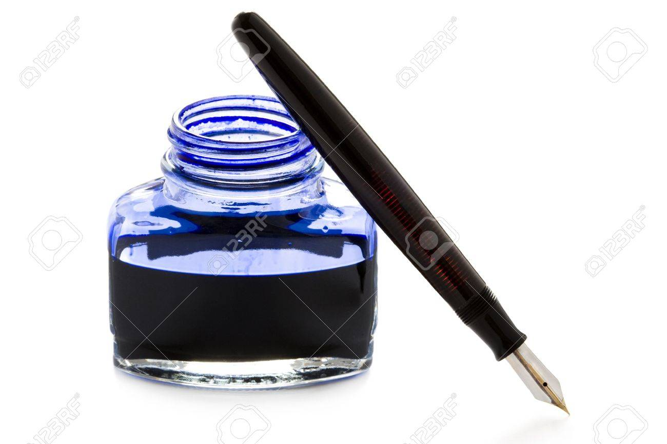 a vintage fountain pen leaning against an open bottle of ink Stock Photo - 13501496