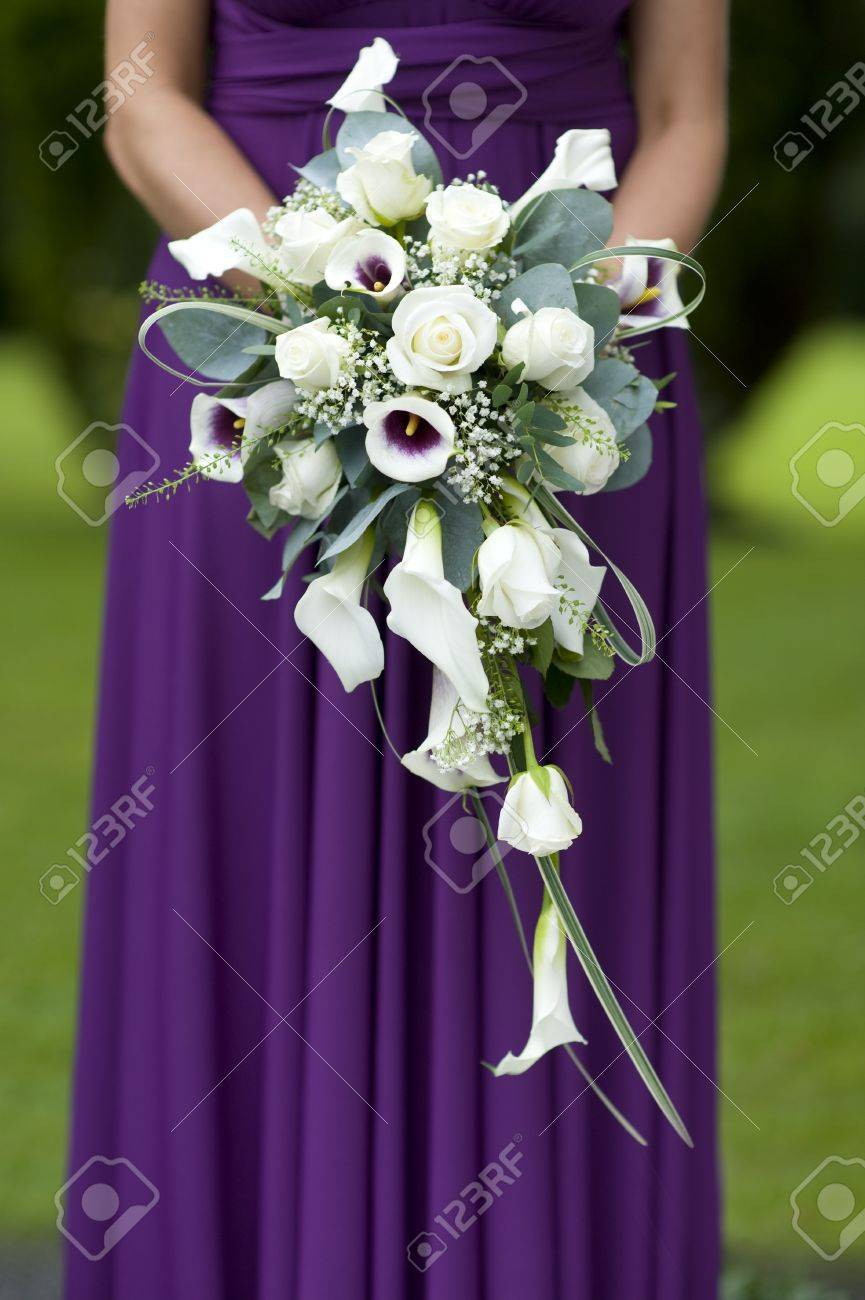 single bridesmaid in a purple dress holding a wedding bouquet Stock Photo - 14585329