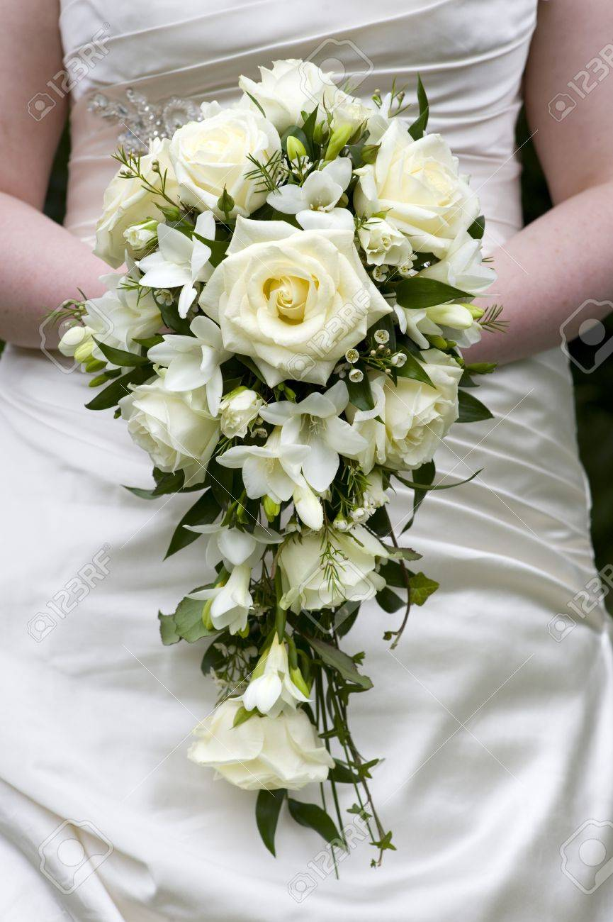 Bride holding a wedding bouquet of white roses stock photo picture bride holding a wedding bouquet of white roses stock photo 15167130 mightylinksfo