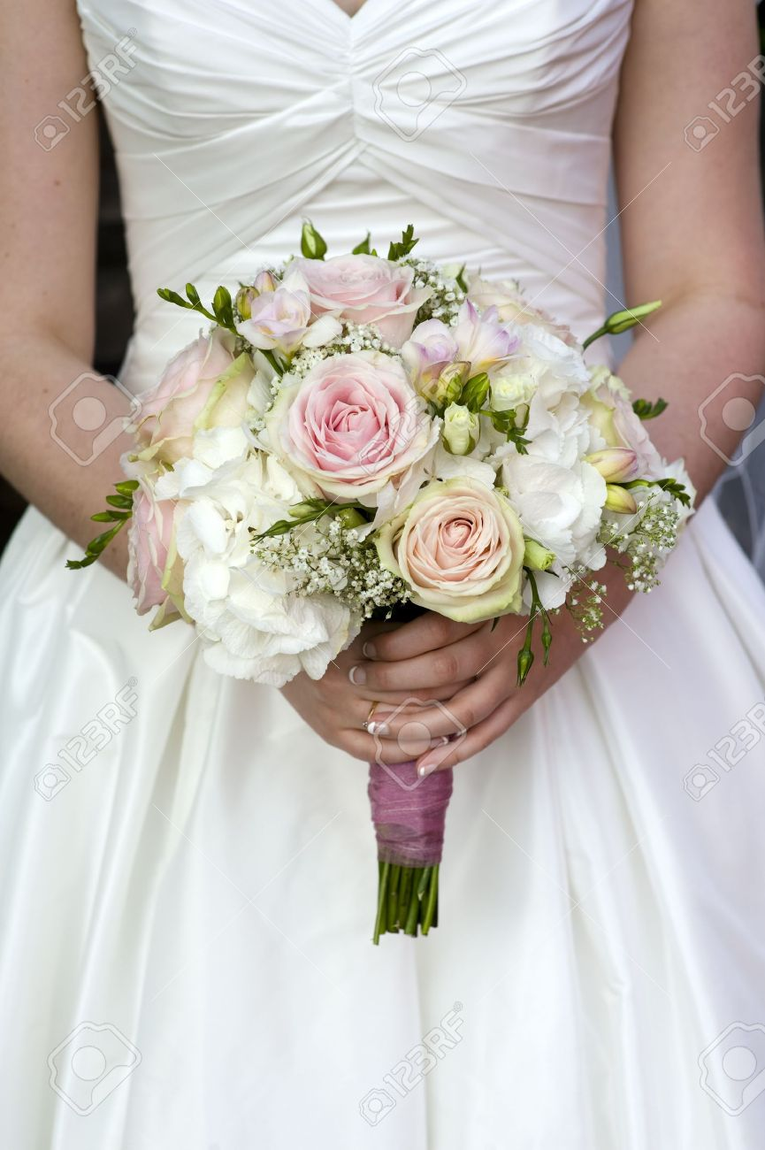 Bride Holding A Bouquet Of Pink And White Wedding Flower Roses Stock ...