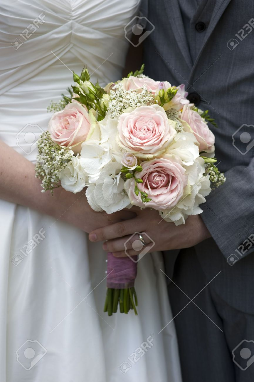 Bride And Groom With Wedding Bouquet Of White Pink Roses Stock Photo