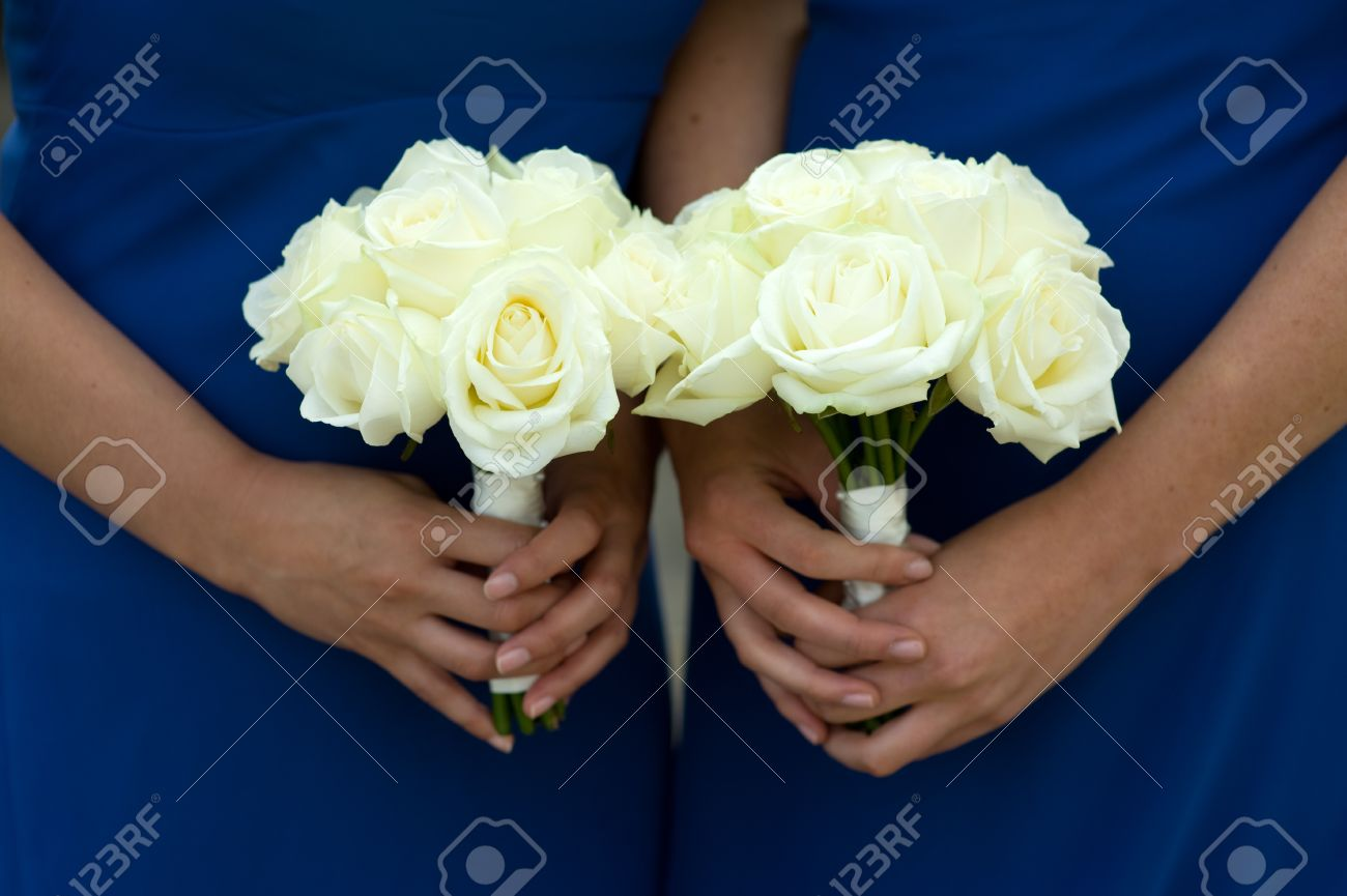 Bridesmaids in blue dresses holding a white rose wedding bouquet bridesmaids in blue dresses holding a white rose wedding bouquet stock photo 15285746 mightylinksfo