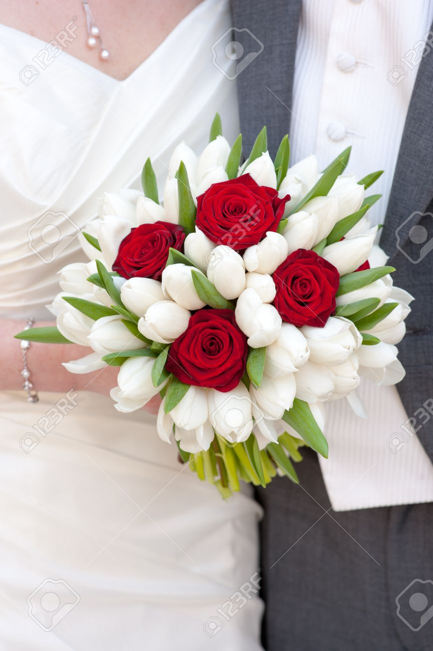 Bride Holding Red Rose And White Tulip Wedding Bouquet Stock Photo