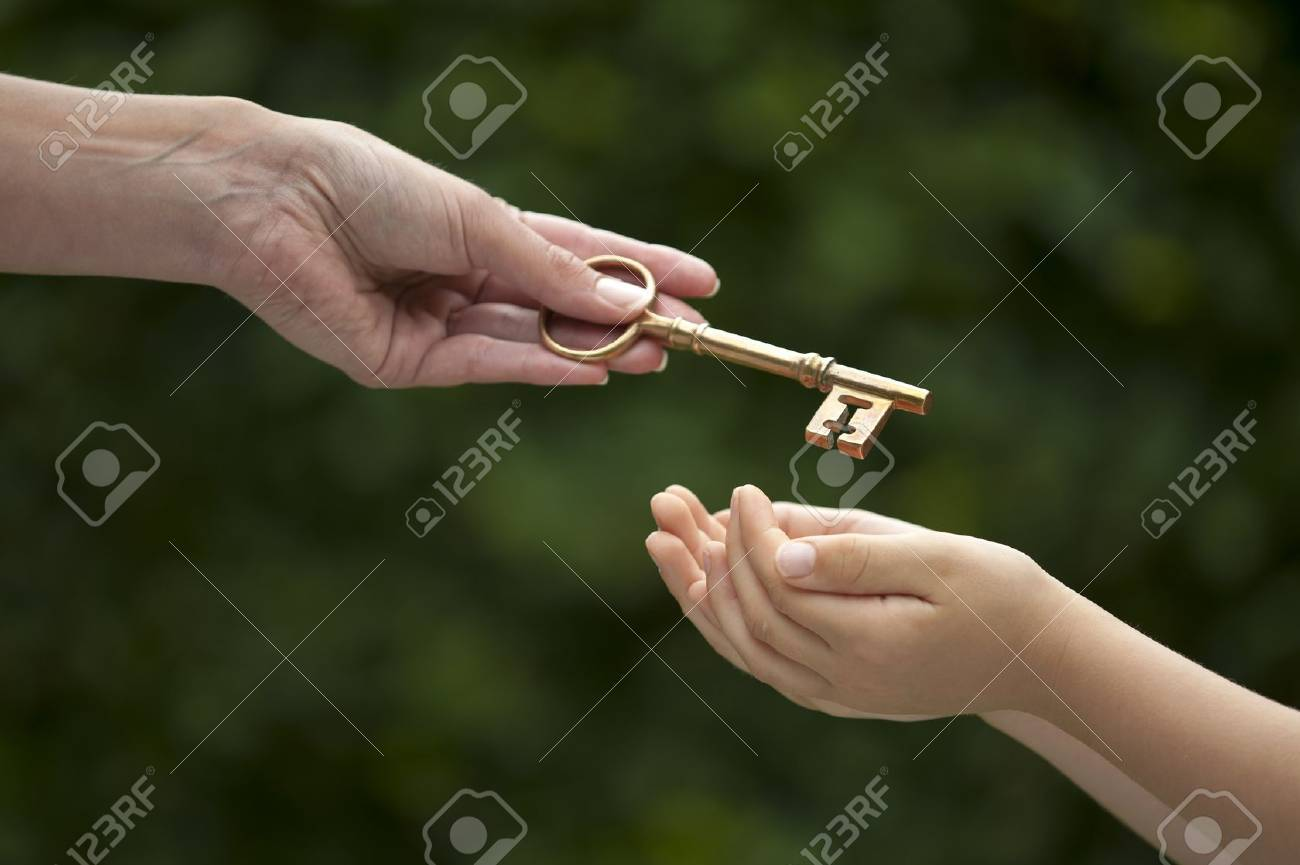 mother handing key to daughter Stock Photo - 19154622