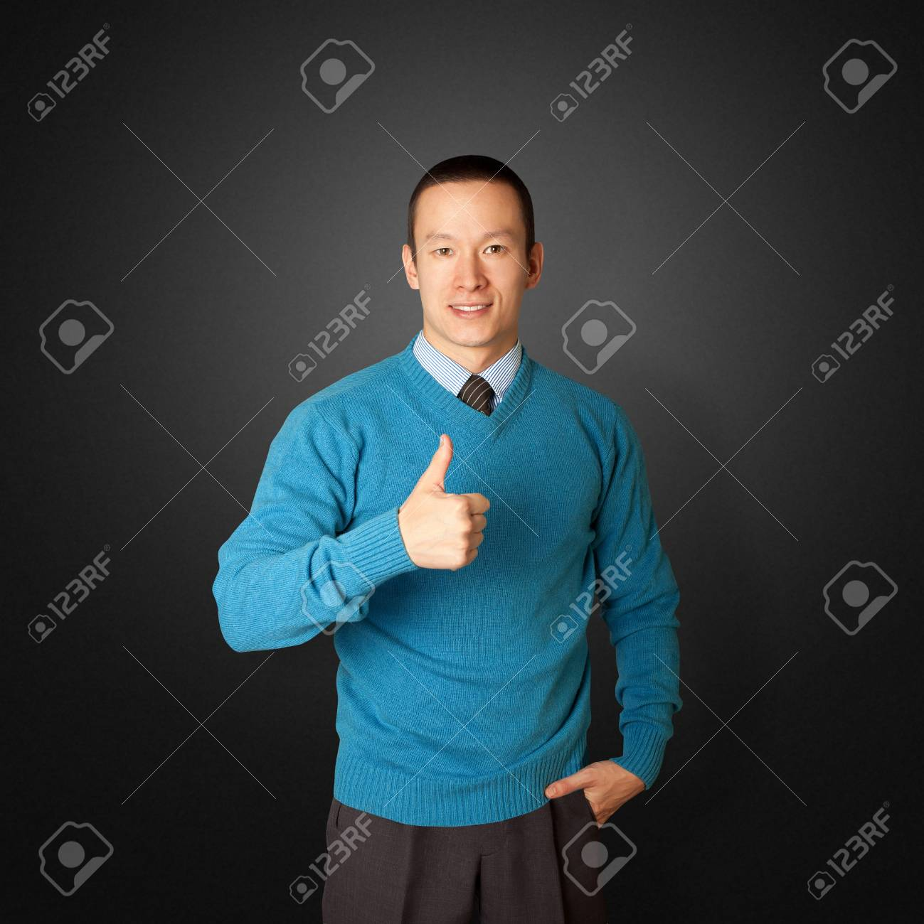 young businessman smiles on camera and shows well done Stock Photo - 8891724