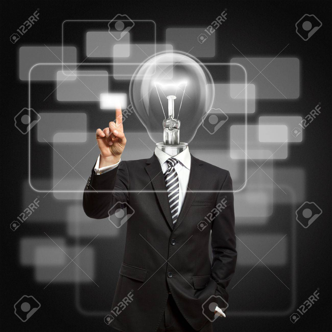 businessman with lamp-head push the button on virtual touch pad Stock Photo - 9094247
