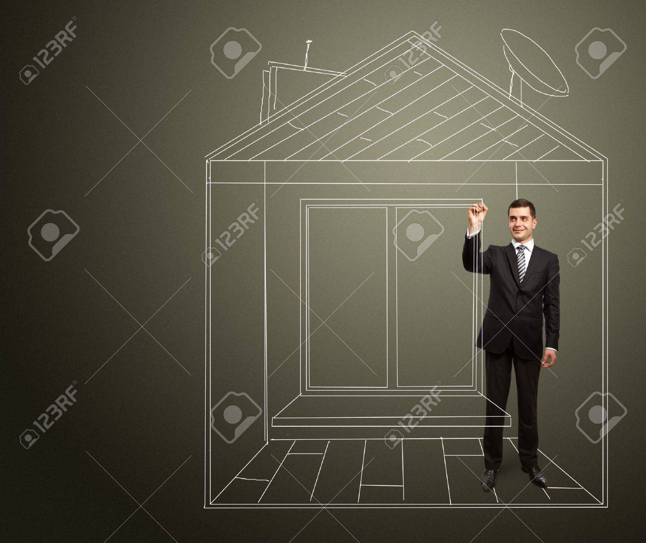 male businessman with marker in fictional house writting something on glass writeboard Stock Photo - 9287113