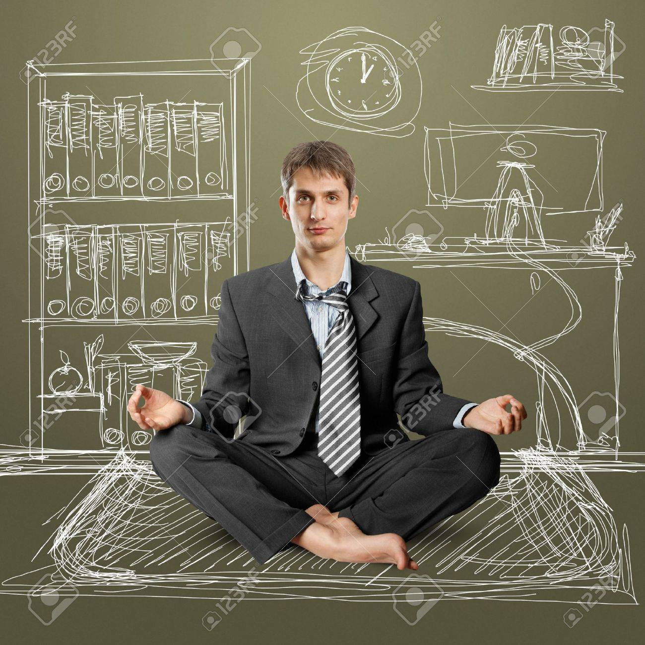 businessman in lotus pose meditating at the office Stock Photo - 9391739