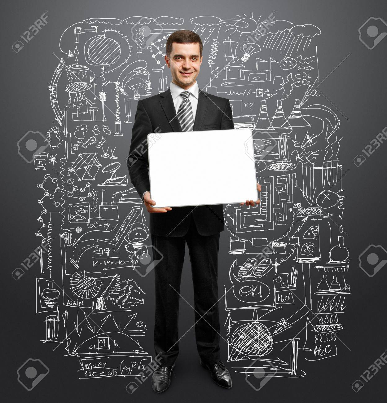 businessman holding empty write board in his hands Stock Photo - 9391740