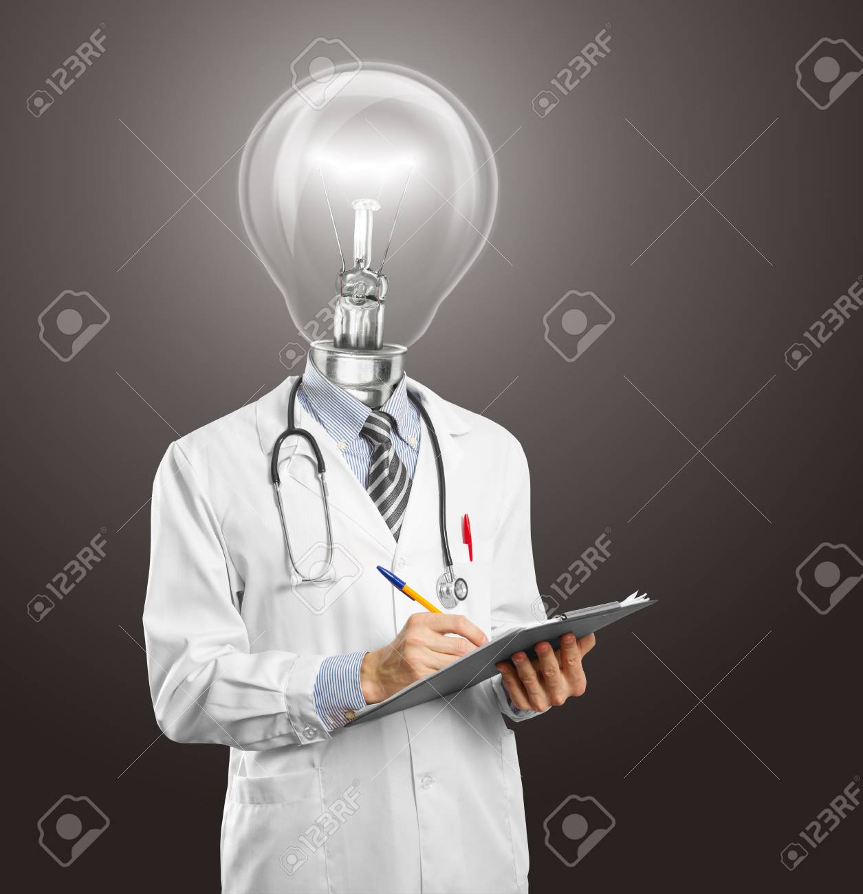 lamphead doctor writing something on clipboard Stock Photo - 11394118