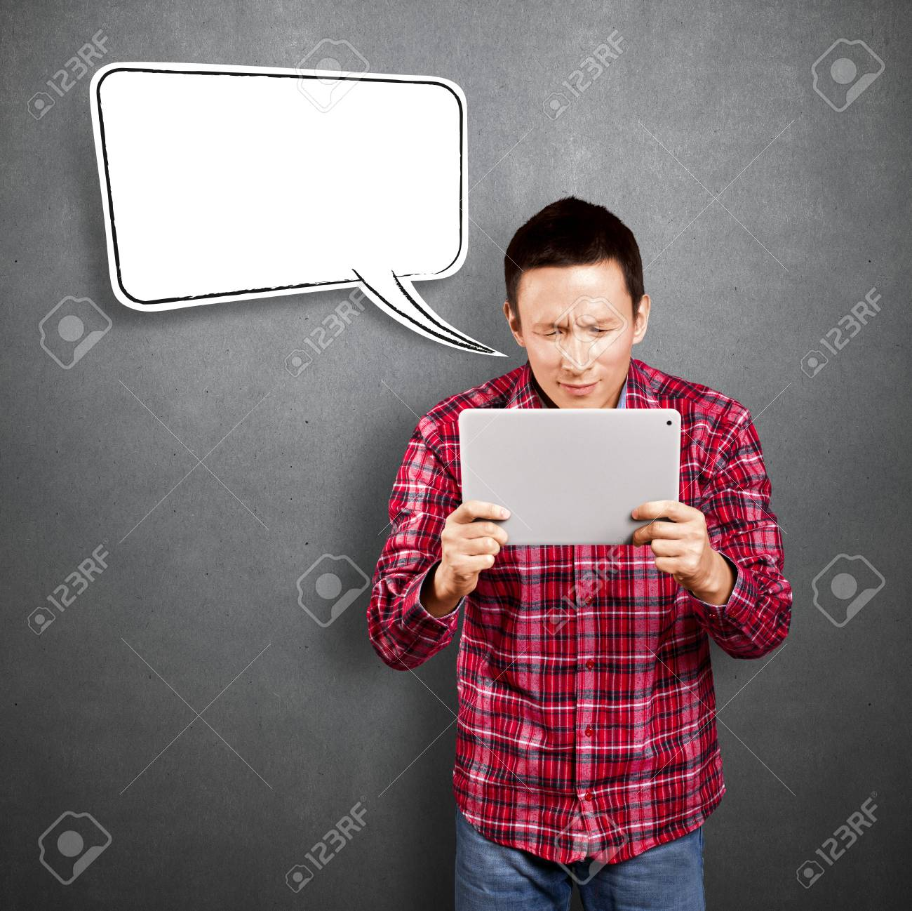 Asian man with speech bubble and touch pad in his hands embarrassed with news Stock Photo - 17237426