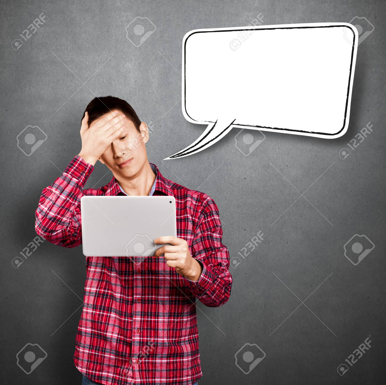 Asian man with speech bubble and touch pad in his hands embarrassed with news Stock Photo - 17237444