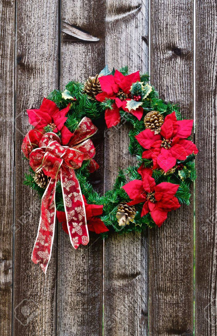 Christmas flower wreath on rustic wooden fence Stock Photo - 15292037