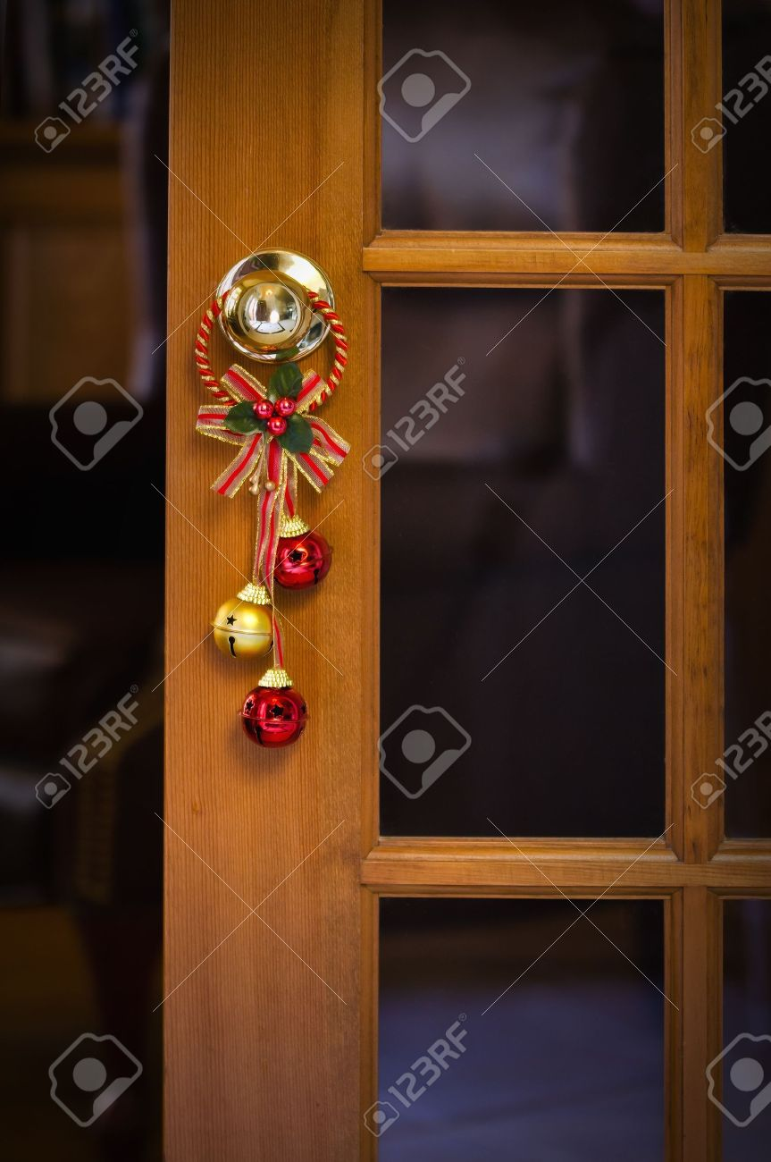 Charmant Christmas Bells Hanging On The Door Knob Stock Photo   16665552