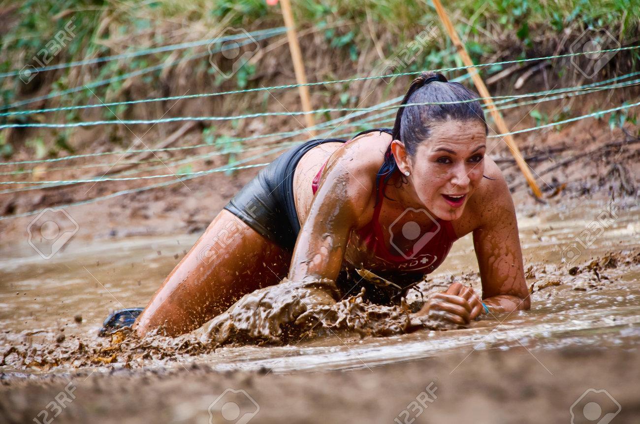Dallas, USA - September 15, 2012 - Mud race participant at a mud pit. Dash of the Titans Dallas Texas Mud Run Race. Stock Photo - 20803983