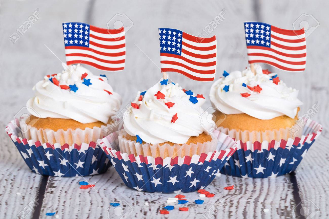 cfe6d23d28f Patriotic cupcakes with sprinkles and American flags on vintage background  Stock Photo - 41103619