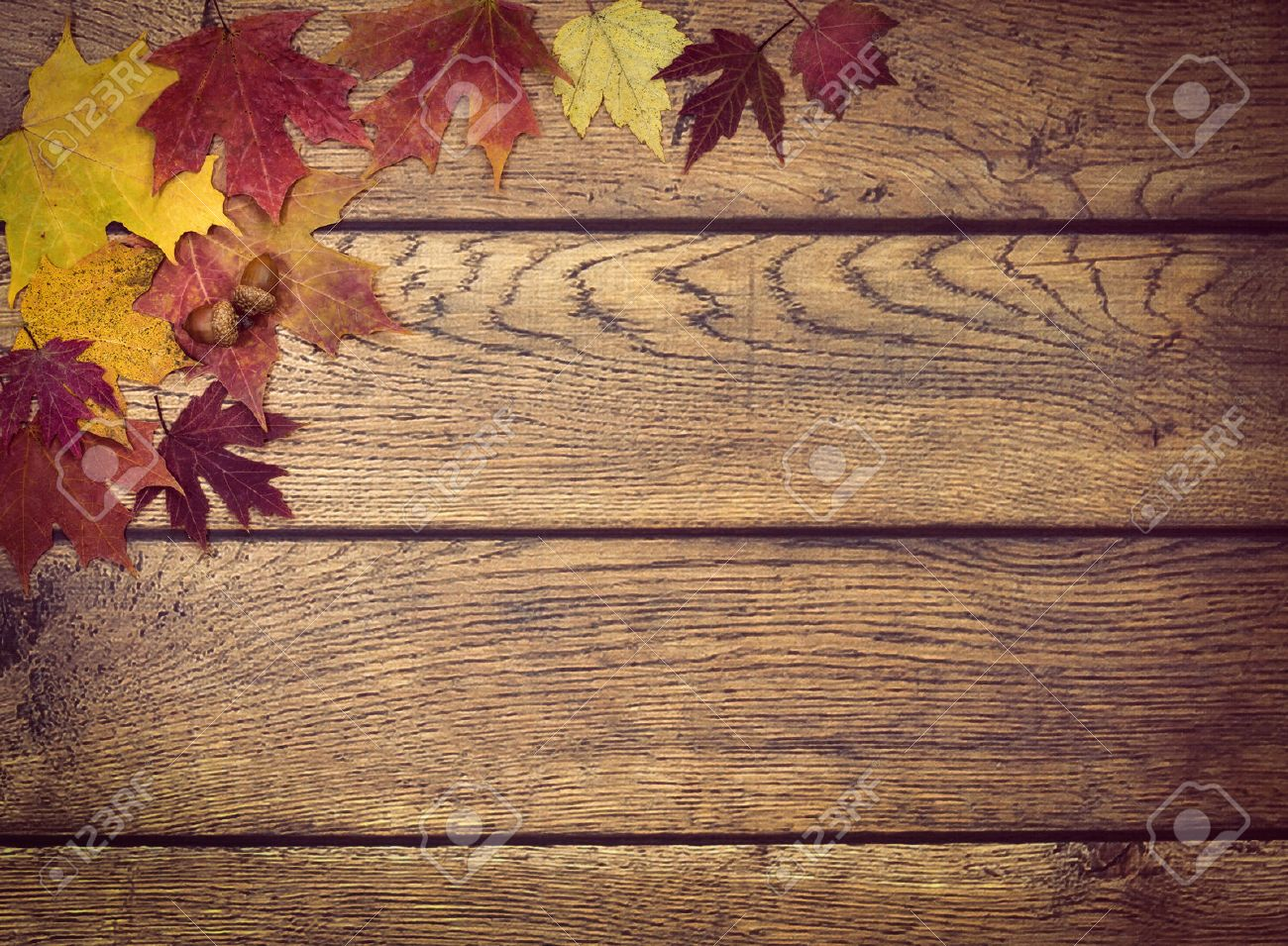 Autumn Leaves And Acorns On Rustic Wooden Background Fall With Copy Space Stock