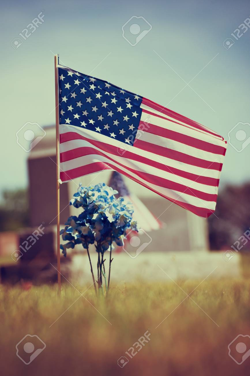 American Veteran Flag In The Cemetery. Vintage Filter Effects. Stock ...