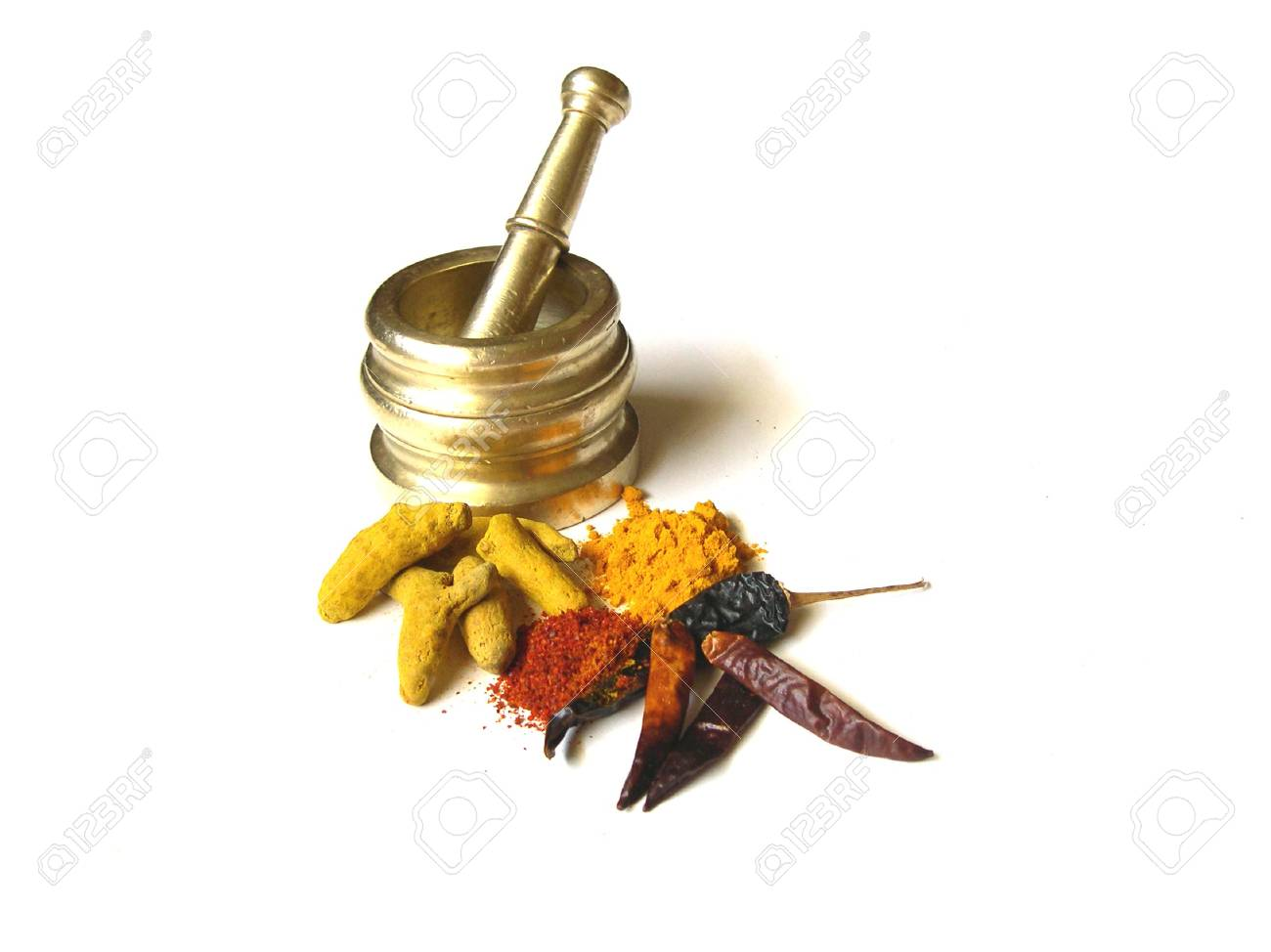 Chilies and Turmeric- Whole and Powdered with Mortar Stock Photo - 5277712