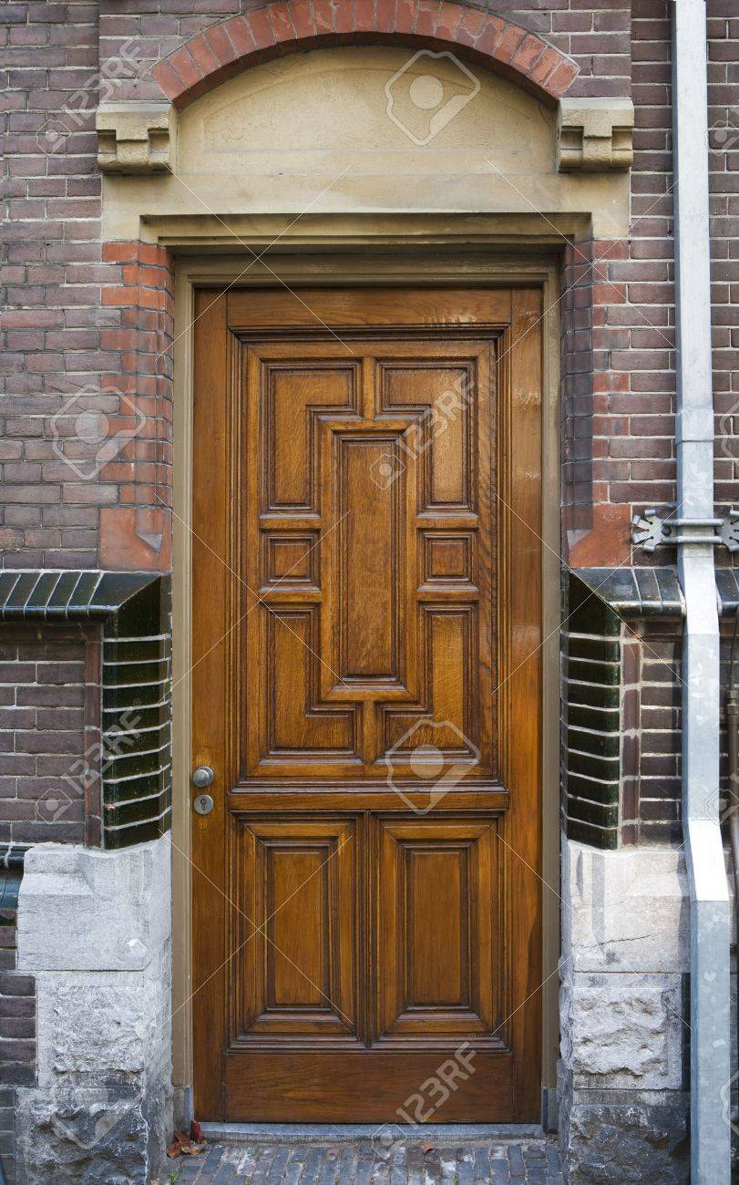 1920s paneled oak door; frame decorated with sandstone and glazed bricks Stock Photo - 3049546 & 1920s Paneled Oak Door; Frame Decorated With Sandstone And Glazed ... Pezcame.Com