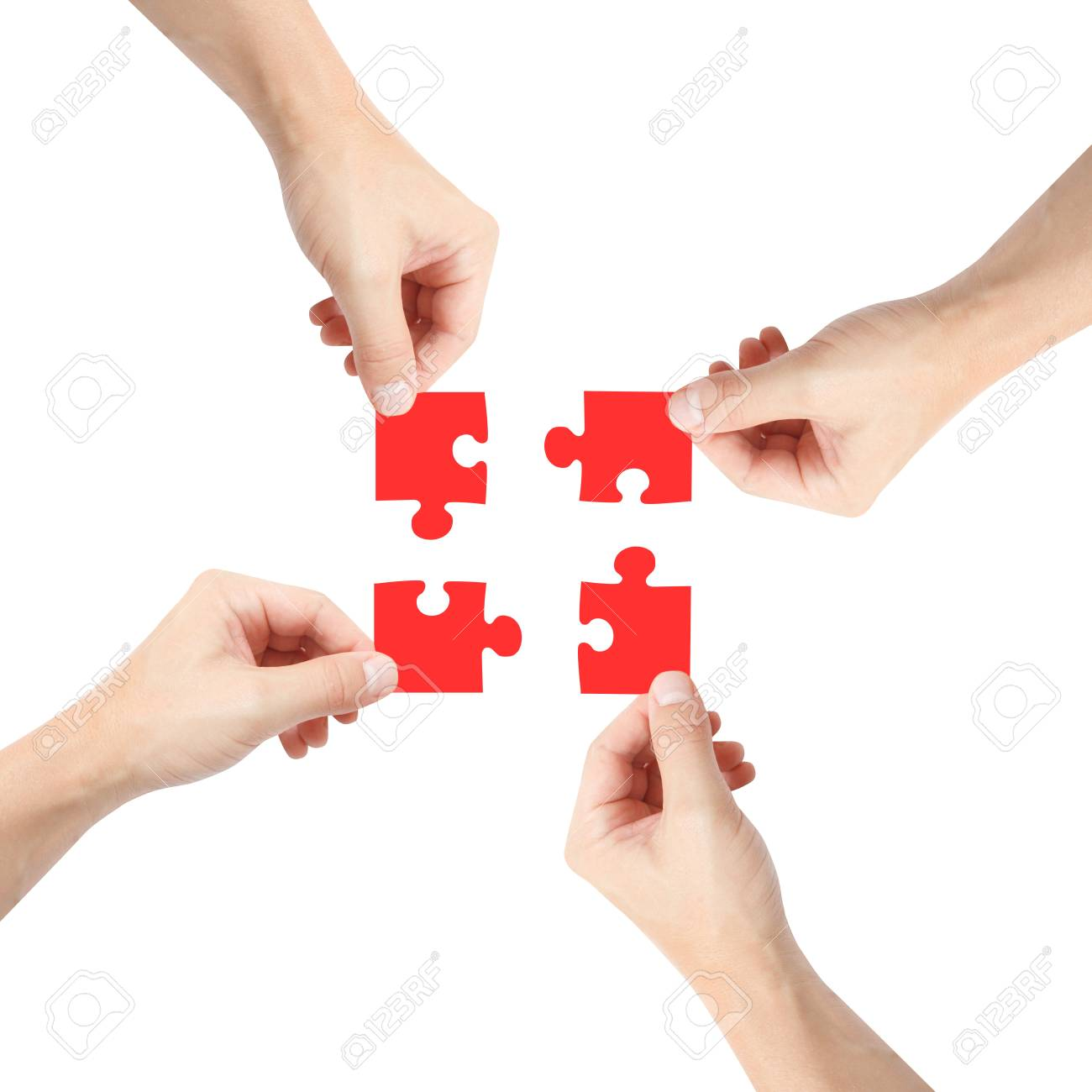 Solving a puzzle with teamwork Stock Photo - 8536259