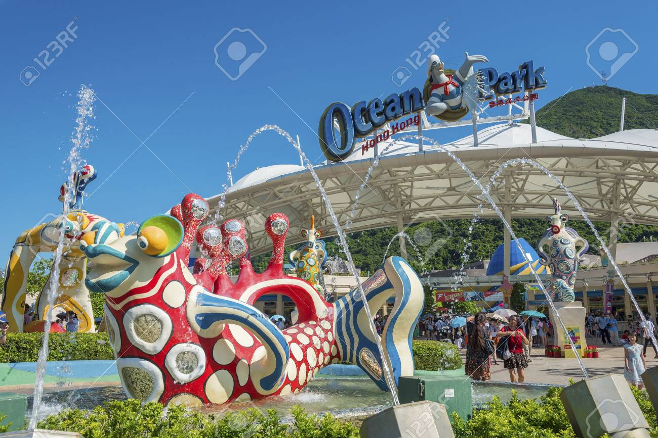 Hong Kong, China - July 24, 2016 : Tourist at the main entrance of Ocean Park Hong Kong. Ocean Park is an animal theme park exhibits such as grant panda and dolphin. It is one of the famous theme parks in Hong Kong. - 75772723