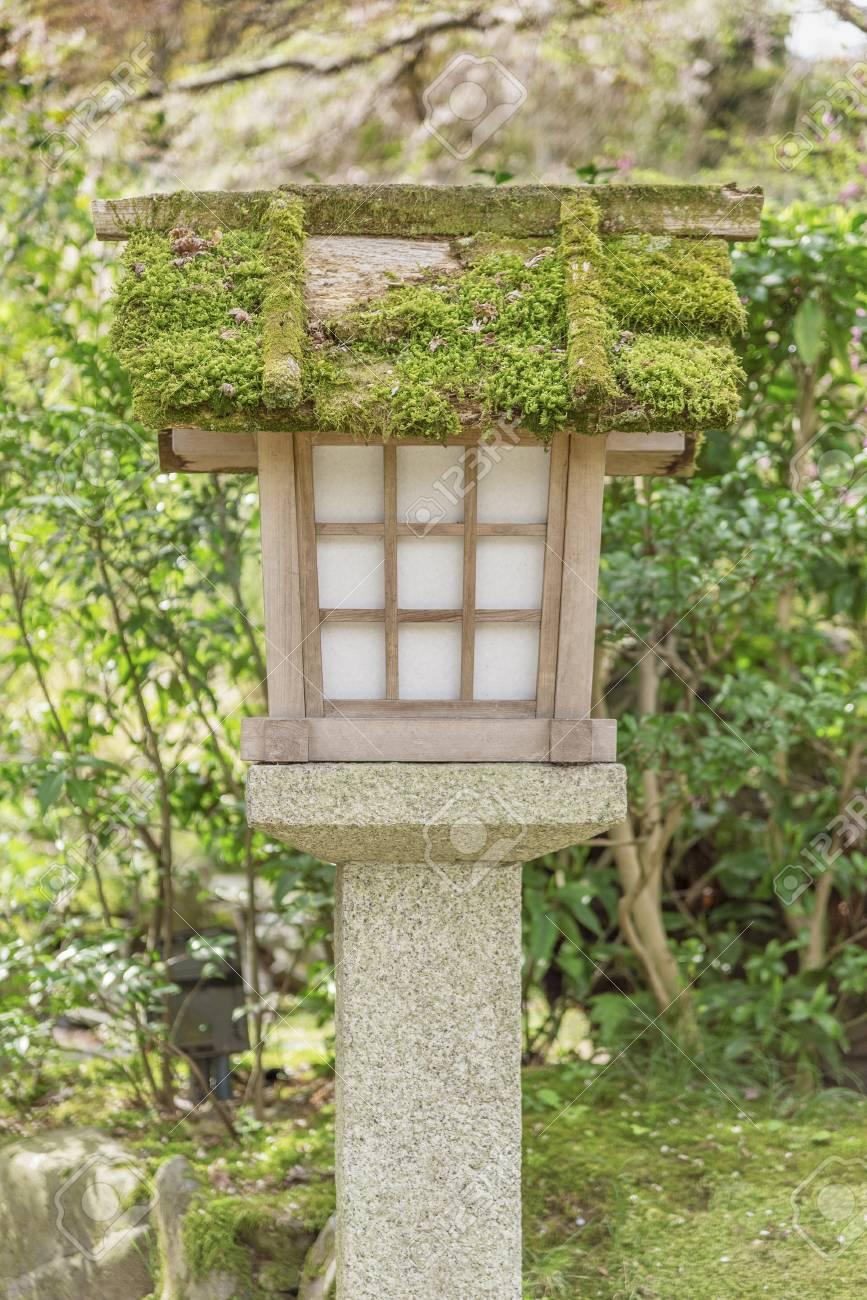 Japanese Wooden Lantern In Japanese Garden