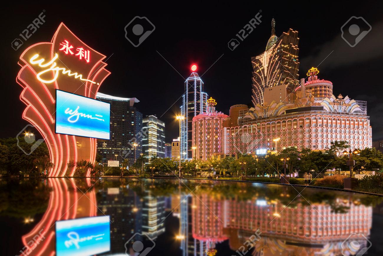 MACAU, CHINA - JUNE 30, 2016: Wynn Casino and Grand Casino Lisboa on June 30, 2016 in Macau. Macau is the world's top casino market and Casino Lisboa is one of the most well known casinos in the city. - 91068478