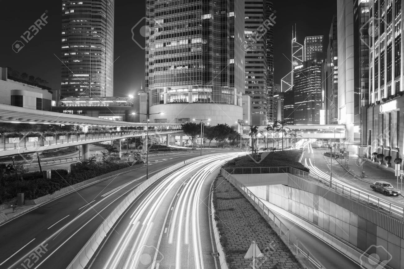 Traffic in downtown of Hong Kong city at night - 135690754