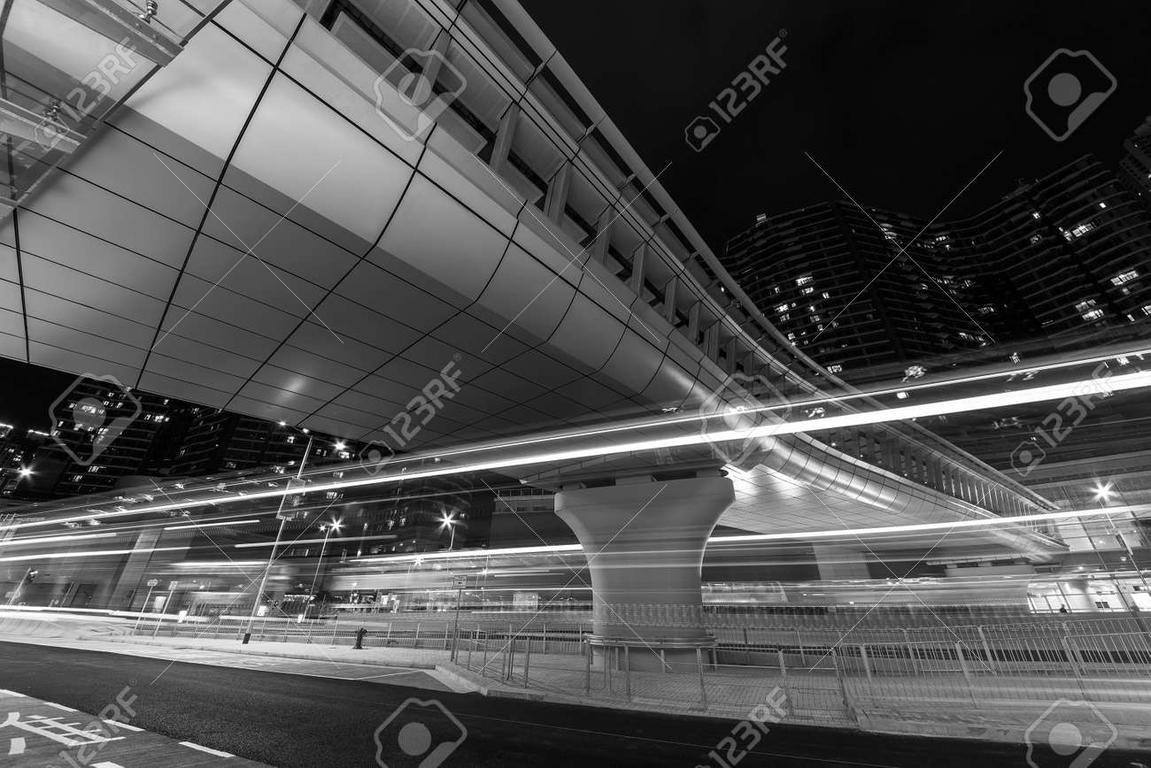 Light trail of traffic in downtown district of Hong Kong city at night - 171283997