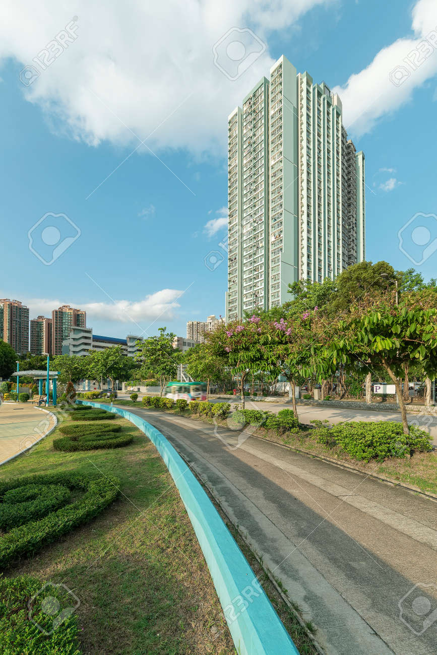 High rise residential building and road in Hong Kong city - 171284044