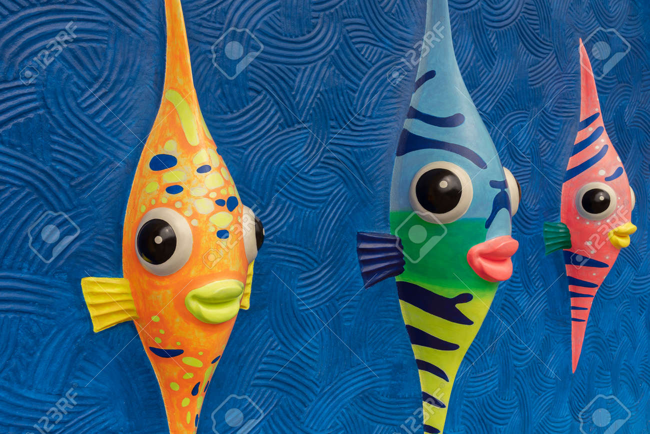 Funny cartoon colorful fish sculpture on wall - 172200086