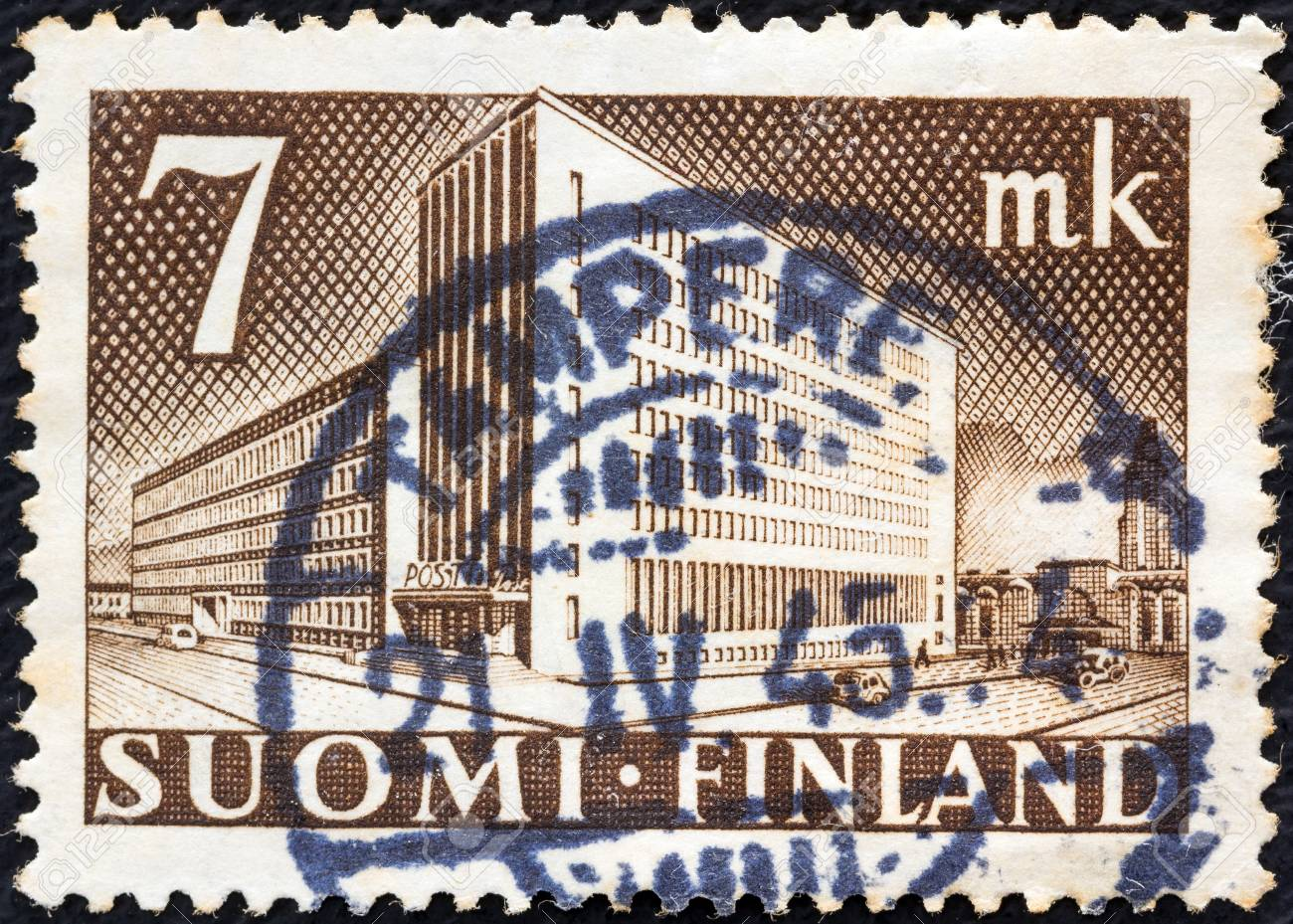 FINLAND - CIRCA 1942: A stamp printed in Finland shows Main Post Office, Helsinki, circa 1942.  Stock Photo - 15944499