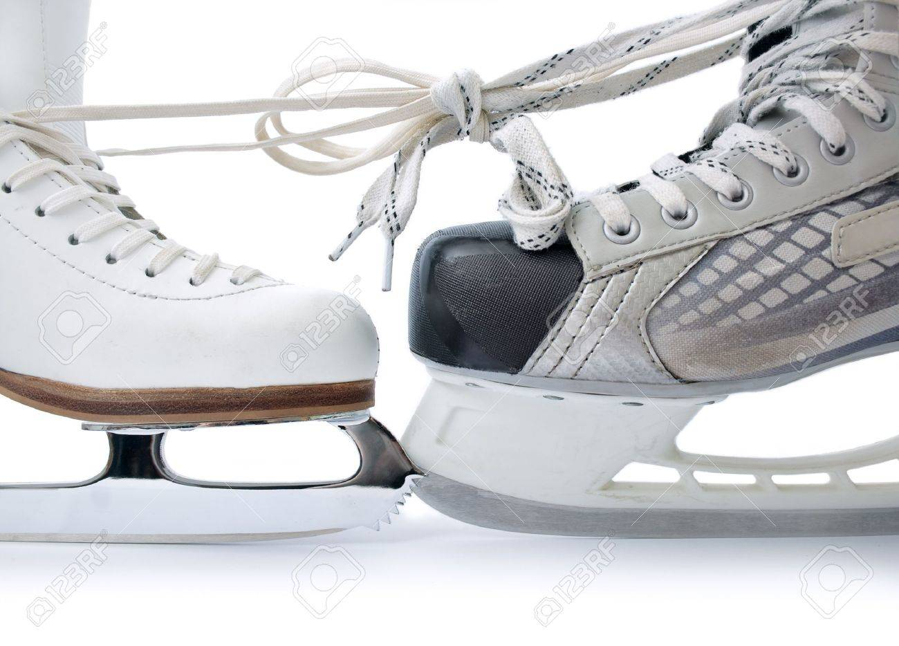 Skate for figure skating and  hockey skate tied against each other close up isolated on white background Stock Photo - 8871194