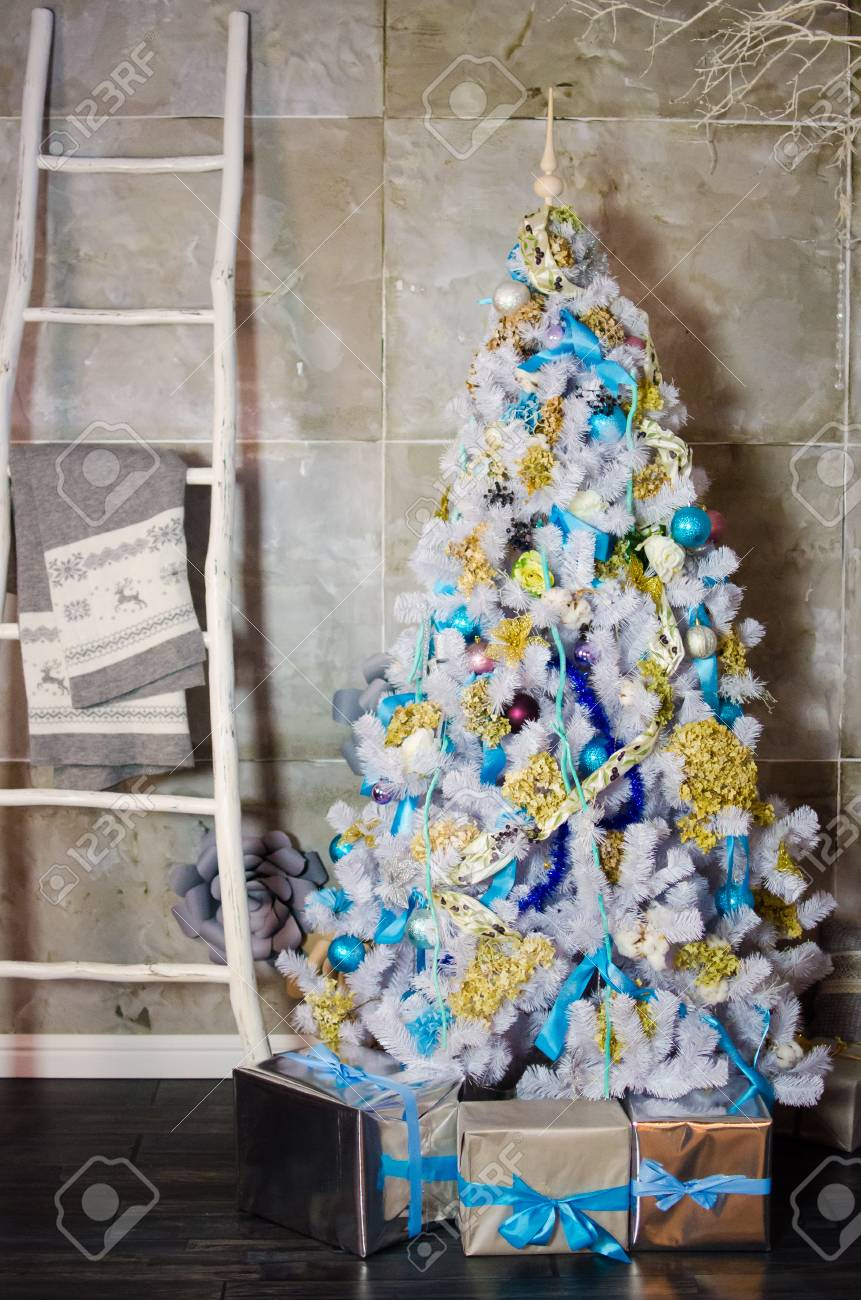 White Christmas Tree With Blue Decorations  from previews.123rf.com