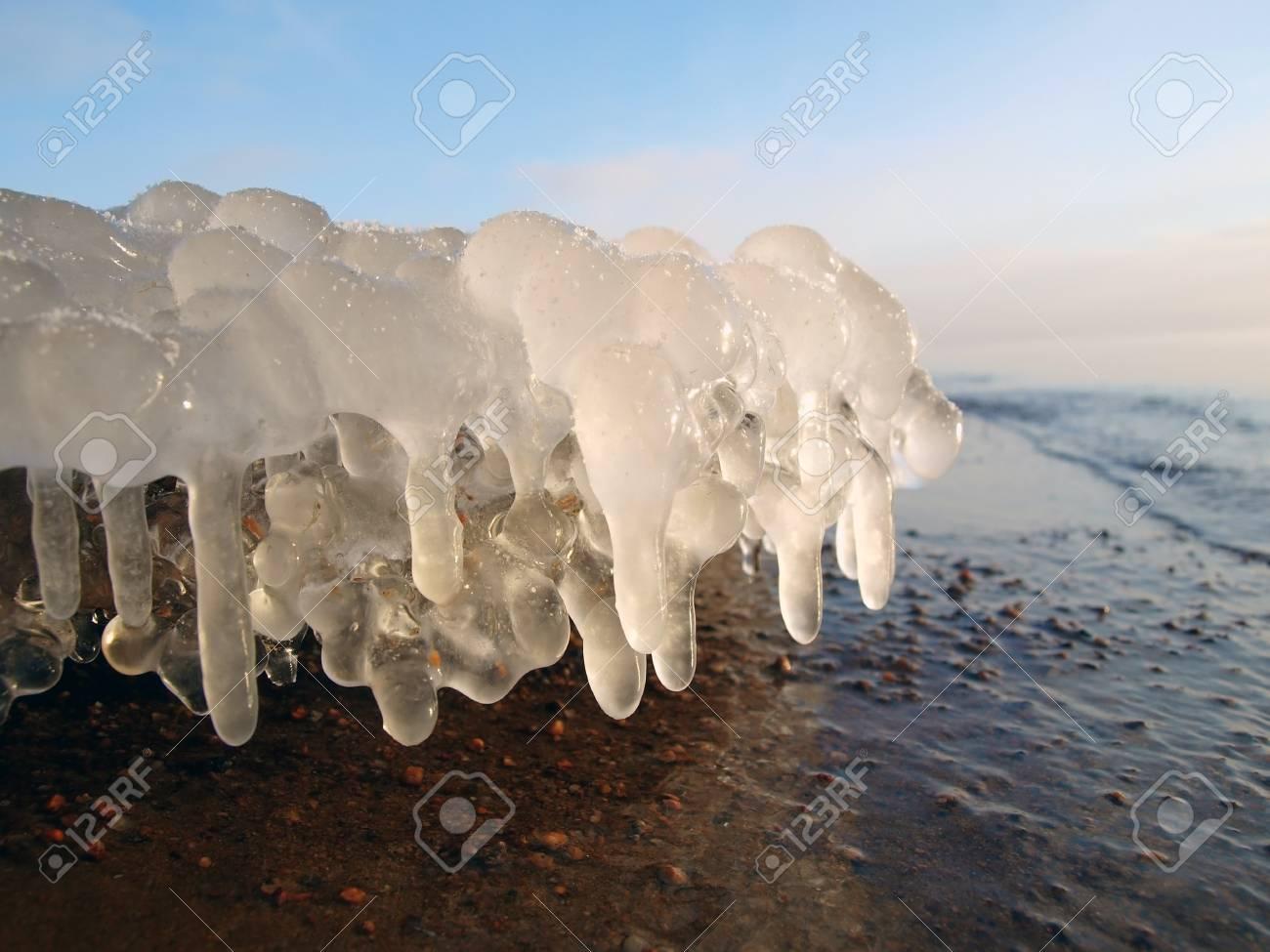 Beautiful Ice stalactites on the lake shore Stock Photo - 8462574